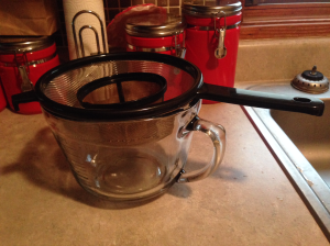 Use a fine mesh strainer and coffee filters or cheesecloth to separate the good liquid mixture from the leftover coffee grounds